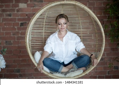 Saint Petersburg, Russia, July, 2019 Yoga practice, woman meditating in the chair