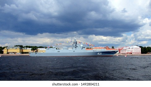 Saint Petersburg / Russia - July, 23, 2019: battleship  '431' on the Neva River (in preparation for the Navy Day parade) right before the storm. Big cloud above the battleship.