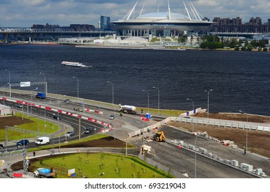 SAINT PETERSBURG, RUSSIA - JULY 3, 2017.Road under construction and Krestovsky Stadium,  also called Zenit Arena - a football stadium, which was opened in 2017 for the FIFA Confederations Cup