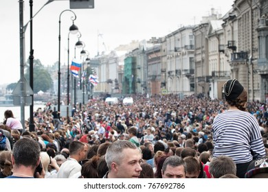 Saint Petersburg, Russia - July 30, 2017: crowd of people during holiday, mob stormed through streets, human curiosity, crowd of curious, bread and circuses like thousands of years ago