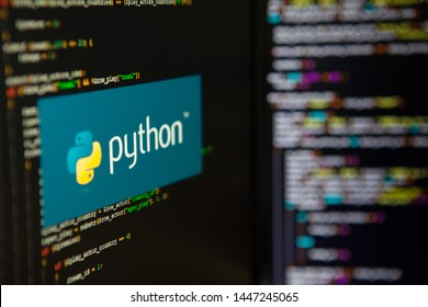 SAINT PETERSBURG, RUSSIA - JULY 4, 2019: Programming language, Python inscription on the background of computer code.