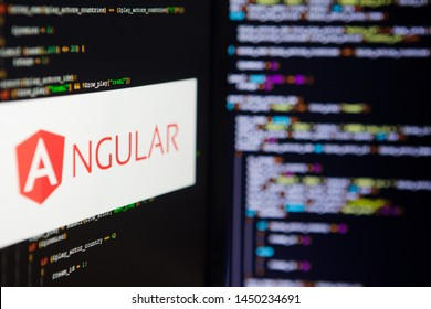 SAINT PETERSBURG, RUSSIA - JULY 4, 2019: Programming language, Angular inscription on the background of computer code.