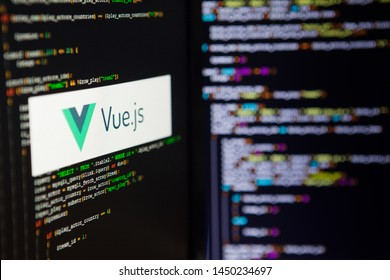SAINT PETERSBURG, RUSSIA - JULY 4, 2019: Programming language, Vue inscription on the background of computer code.