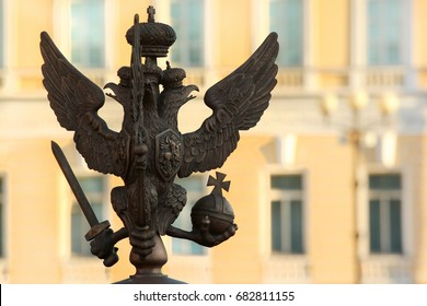 SAINT PETERSBURG, RUSSIA - JULY 4, 2017: Silhouette of bronze double-headed eagle with sword, orb and cross. Symbol and coat of arms of Russia. Fragment of the Alexander Column on Palace Square.