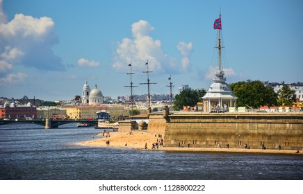 Saint Petersburg / Russia - July 5, 2018: view of the Neva with the wall of Peter and Paul Fortress and Naryshkin bastion and the Vasilyevsky island in the background