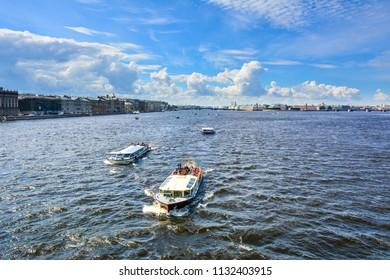Saint Petersburg / Russia — July 5, 2018: Tourist boats on the Neva River, Saint Petersburg