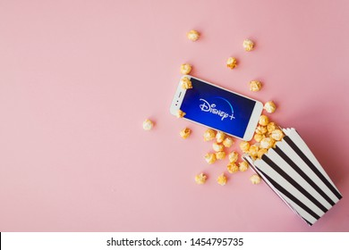 SAINT PETERSBURG, RUSSIA - JULY 7, 2019: Movies and series by subscription, concept. smartphone with Disney plus logo