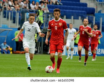 SAINT PETERSBURG, RUSSIA - JUNE 17, 2017. Russian players Fedor Smolov and Denis Glushakov, and New Zealand midfielder Michael McGlinchey in FIFA Confederations Cup match Russia vs New Zealand..