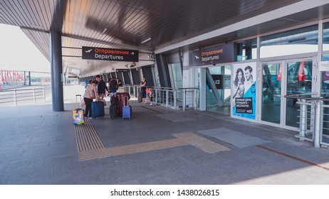 Saint Petersburg / Russia - June 20 2019: Entry at Pulkovo Airport. People with luggage at the entrance to the terminal