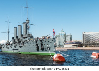 Saint Petersburg, RUSSIA - June 22, 2019: Ancient cruiser Aurora at the pier on the Neva river. Tourists and people visiting the cruiser