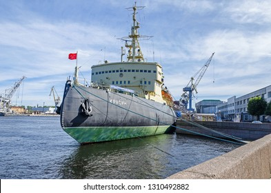 Saint Petersburg, Russia -  June 27, 2018: Icebreaker Krassin built for the Imperial Russian Navy and fully restored to operating condition, now a museum ship. Harbor cranes in the background.