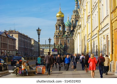 SAINT PETERSBURG, RUSSIA - MAI 10, 2014: walking people in front of church the Savior on Spilled Blood. Spas-na-krovi cathedral The cathedral Has rescued - on - blood