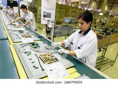 Saint Petersburg, Russia - March 11 2016.  Workers assemble TV in  TPV Technology television assembly factory.