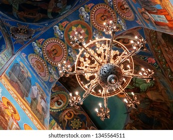 Saint Petersburg, Russia - March 15, 2018: Mosaic ceiling of the Church of the Savior on Blood and chandelier close-up