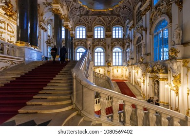 SAINT PETERSBURG, RUSSIA - MARCH 16, 2018: visitors on Jordan staircase of Hermitage museum. The State Hermitage is second largest museum of art and culture in the world, it was founded in 1764