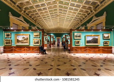 SAINT PETERSBURG, RUSSIA - MARCH 16, 2018: tourists in gallery of Great Hermitage museum. The State Hermitage is second largest museum of art and culture in the world, it was founded in 1764