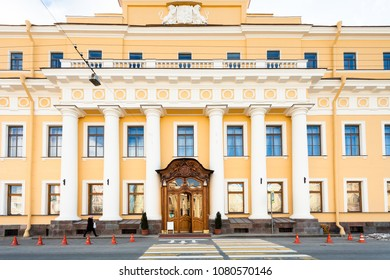 SAINT PETERSBURG, RUSSIA - MARCH 17, 2018: tourist near facade of Yusupov palace on Moyka river embankment. The Moika Palace was primary residence of noble family House of Yusupov in St Petersburg