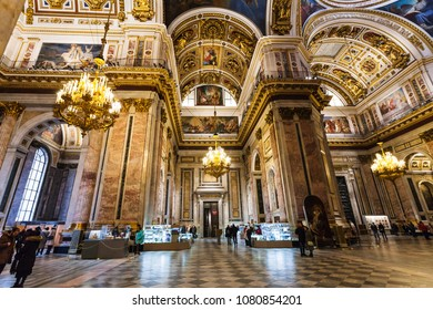 SAINT PETERSBURG, RUSSIA - MARCH 17, 2018: people inside Saint Isaac's Cathedral (Isaakievskiy Sobor) in Saint Petersburg city. The Cathedral is the largest orthodox basilica in the world