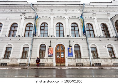 SAINT PETERSBURG, RUSSIA - MARCH 19, 2018: woman near Faberge Museum in Shuvalov Palace on Fontanka River Embankment in Saint Petersburg in snowfall. The Palace has housed the Faberge Museum from 2013