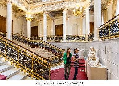 SAINT PETERSBURG, RUSSIA - MARCH 19, 2018: visitors on staircase in Faberge Museum in Shuvalov Palace in Saint Petersburg city. The Palace has housed the Faberge Museum from 2013