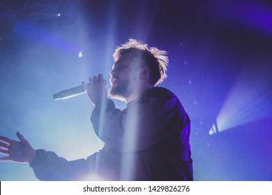 Saint Petersburg, Russia - March 24, 2018: Foucault pendulum (Mayatnic Fuco in russian) rap music festival in sk Yubileynyiy, russian rapper Malbec and Siuzanna