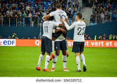 SAINT PETERSBURG, RUSSIA - March 27, 2018: Footballers of the national team of France celebrate a goal scored during a friendly match between national team Russia and France, Russia