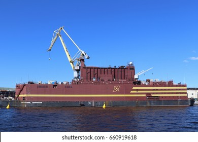 "Saint Petersburg, RUSSIA - MAY 03, 2017: The world's first floating nuclear power block ""Akademik Lomonosov"" at the quay wall of the Baltic shipyard"