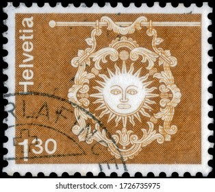 Saint Petersburg, Russia - May 05, 2020: Postage stamp issued in the Switzerland with the image of the Inn sign Zur Sonne, Toggenburg, St. Gallen. From the series on Architecture and Handicrafts