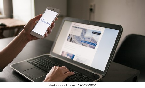 SAINT PETERSBURG, RUSSIA - MAY 14, 2019: user of the site and application. Website and logo of Russian company Etalon group on the screens of gadgets. Cross platform services. Illustrative editorial