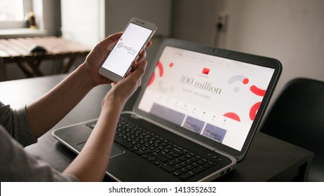SAINT PETERSBURG, RUSSIA - MAY 14, 2019: user of the site and application. Website and logo of Russian company mail.ru group on the screens of gadgets. Cross platform services. Illustrative editorial