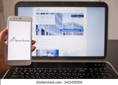 SAINT PETERSBURG, RUSSIA - MAY 14, 2019: Website and logo of the Russian company Etalon group on the screens of gadgets. Russian business, cross-platform services. Illustrative editorial