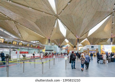 Saint Petersburg, Russia - May 2019: Pulkovo Airport architecture inside departure terminal and passengers, St. Petersburg, Russia. Pulkovo Airport is an airport serving St. Petersburg, Russia.