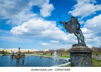 Saint Petersburg, Russia - May 2019: Peterhof fountains and palace view of the Upper Park. The Peterhof Palace is a series of palaces and gardens and a popular tourist sight.