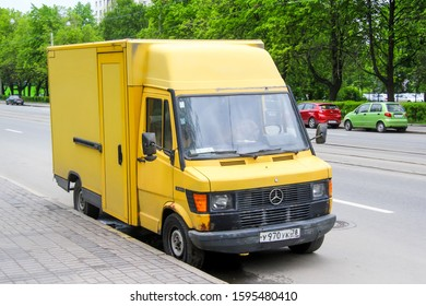 Saint Petersburg, Russia - May 26, 2013: Yellow delivery step van Mercedes-Benz T1 308D in the city street.