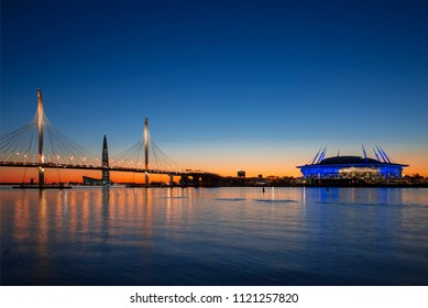 "SAINT PETERSBURG, RUSSIA - MAY 28, 2018:Stadium ""Saint Petersburg Arena"" on Krestovsky island and Cable-stayed bridge Western high-speed diameter across Peter's fairway in St. Petersburg at sunset, Ru"