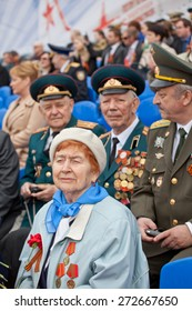 Saint Petersburg /RUSSIA - MAY 9: Old  woman veteran of  WWII  decorated with  medals and soldiers  during festivities devoted to anniversary of Victory Day on May 9, 2013 in Saint- Petersburg