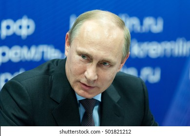 "Saint Petersburg, Russia - November 22 2013. President of the Russian Federation Vladimir  Putin during his visit to JSC ""Klimov"" - a leading developer of gas turbine engines"