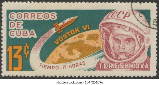 Saint Petersburg, Russia - November 27, 2018: Postage stamp printed in Cuba dedicated to the flight of the Soviet spacecraft Vostok-6 with the first woman on board Valentina Tereshkova, circa 1964.
