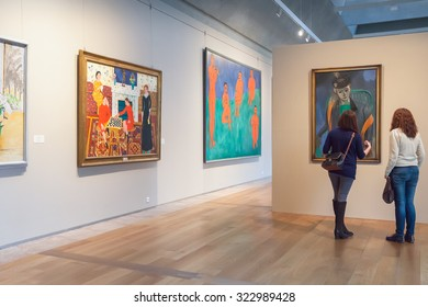 SAINT PETERSBURG, RUSSIA - OCTOBER 01, 2015: Two girls looking at Impressionist paintings Matisse at the Museum of the General Staff (branch of  Hermitage - one of the largest museums in the world)