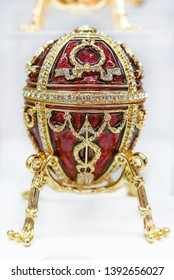 Saint Petersburg, Russia - October 05, 2015: Ornate red and gold Faberge egg souvenir on display in the official store at the Faberge museum for sale