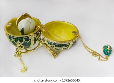 Saint Petersburg, Russia - October 05, 2015: Ornate green and gold Faberge egg souvenir on display in the official store at Faberge museum for sale