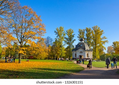 SAINT PETERSBURG, RUSSIA – OCTOBER 14, 2018: People in Moskovsky Victory Park with Memorial chapel on the background