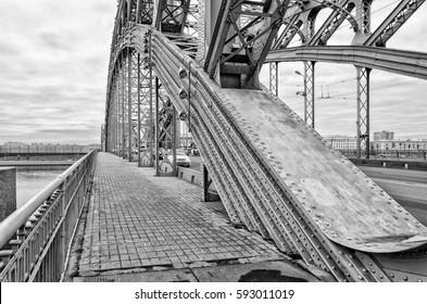 Saint Petersburg, Russia. October 16, 2016. A pavement and constuction details of Bolsheokhtinsky bridge. B/W image.