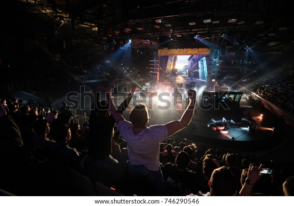 SAINT PETERSBURG, RUSSIA - OCTOBER 2017: Counter Strike: Global Offensive cyber sport event. Main venue and fan of one of the teams in front.