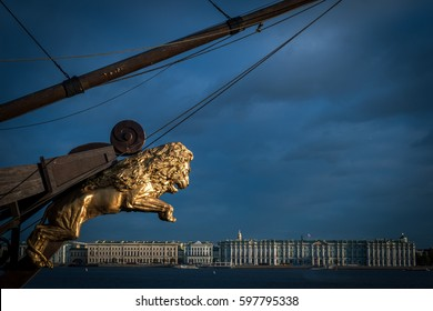 SAINT PETERSBURG, RUSSIA - OCTOBER 8, 2015: The golden figure of a lion on the bow of a sailboat against the backdrop of the State Hermitage