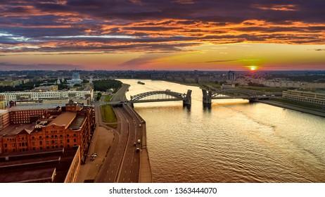 Saint Petersburg. Russia. Panorama of Petersburg with the Bolsheokhtinsky bridge. Bridge of Peter the Great at sunset. The drawbridges. Neva River navigation. Cities of Russia. Petersburg water tours.