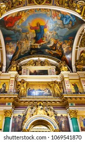 SAINT PETERSBURG, RUSSIA - September 11, 2017:  Rich interior decoration of St. Isaac's Cathedral, icons, wall murals and ceiling fresco in the church
