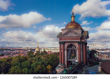 SAINT PETERSBURG, RUSSIA - SEPTEMBER 19, 2018: One of the bell towers at Saint Isaac's Cathedral and the skyline of the city in the background