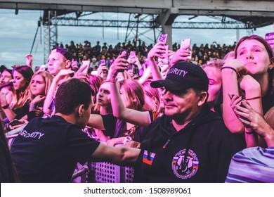 Saint Petersburg, Russia - September 7, 2019: Foucault pendulum (Mayatnic Fuco in russian) rap music festival in creative space Street Art Museum, security guards control the crowd