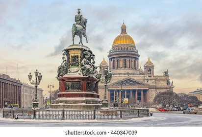 Saint Petersburg, Russia. St. Isaac cathedral and  The Monument to Nicholas I in the snow. Shot from the back of the monument.